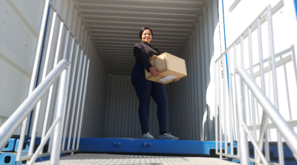 lady smiling in a container unit